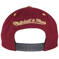 Mitchell and Ness embroidered in gold threading on the back of this Cavaliers maroon snapback hat.