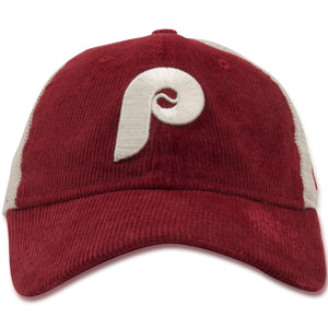 The vintage Cooperstown Philadelphia Phillies Trucker Hat features a maroon corduroy crown, a maroon curved brim, and a meshback with the Philadelphia Phillies throwback Cooperstown logo embroidered on the front in an off-white thread