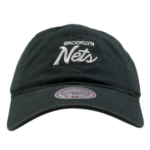 embroidered on the front of the Brooklyn Nets mitchell and ness script black dad hat is the Brooklyn Nets lettering embroidered in white