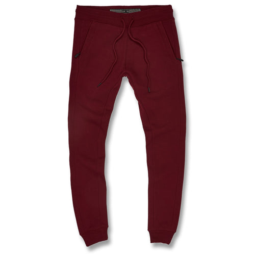 the wine colored jordan craig jogger pants are solid maroon with tapered ankles