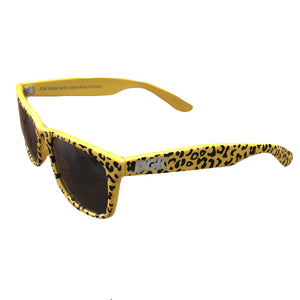 the dgk yellow cheetah print sunglasses have a yellow and black cheetah print frame