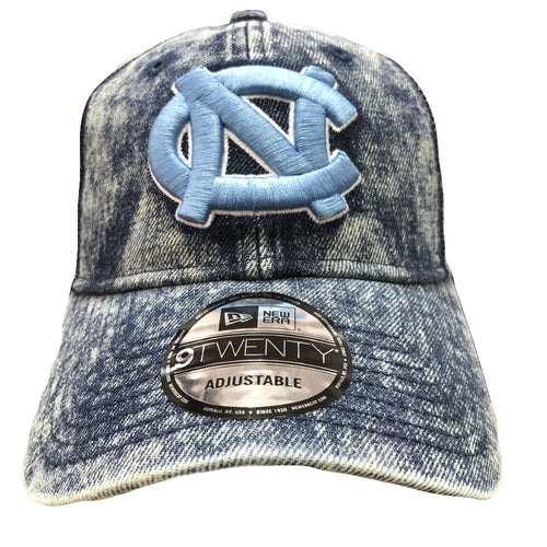 Embroidered on the front of bleached denim UNC blue dad hat is the University of North Carolina logo embroidered in unc blue and white