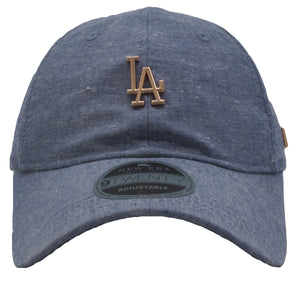 on the front of the los angeles dodgers denim adjustable dad hat has the los angeles dodgers logo in rose gold metal