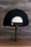 the back of the Black Circle Patch Snapback Skater Hat | DC Shoes Black Bottom Snap Back Cap is all black with a matching adjustable strap