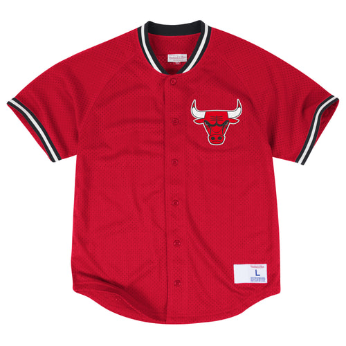 the throwback chicago bulls mitchell and ness jersey is solid red with black and white accents and a bulls logo embroidered on the left chest