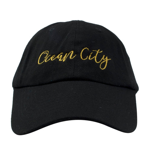 embroidered on the front of the ocean city nj black dad hat is the word ocean city in metallic gold