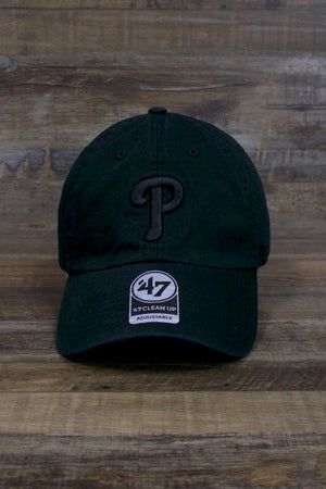 on the front of the Philadelphia Phillies All Black Dad Hat | Black on Black Tonal Clean Up Baseball Cap is a monochromatic Phillies current logo