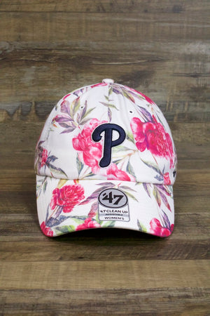on the front of the Philadelphia Phillies Floral Womens Dad Hat | 47 Brand Peony White Baseball Cap is a dark blue Phils P logo and lots of flowers