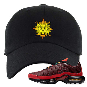 Embroidered on the front of the black air max plus sunburst sneaker matching black dad hat is the vintage lion head
