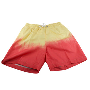 The coral reef dip dyed swim trunks go from light yellow to coral