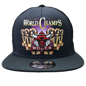 On the front of the Chicago Bulls Trucker snapback hat is the World Champs printed logo and the Chicago Bulls logo embroidered in red, white, and black