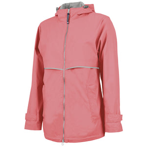 on the front of the coral women's zip-up windbreaker jacket is a reflective zipper