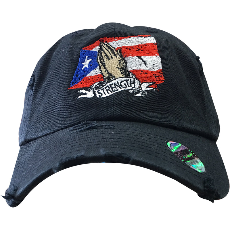 on the front of the pray for puerto rico distressed dad hat is a puerto rican flag, praying hands and the word strength