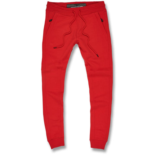 the front of the red jordan craig fleece lined joggers feature an adjustable string with pockets