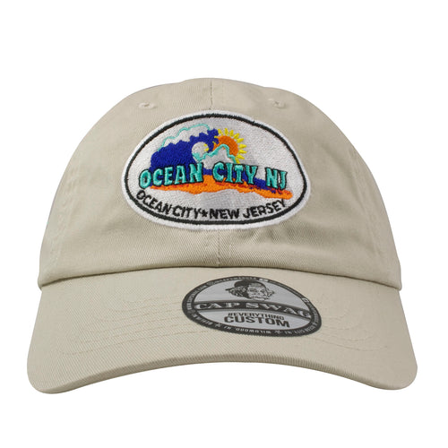 Embroidered on the front of the Ocean City NJ kahki dad hat is the OC NJ logo in blue, teal, black, orange, and yellow