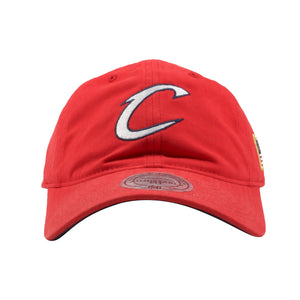 embroidered on the front of the cleveland cavaliers dad hat is the cleveland cavaliers logo in white and navy blue