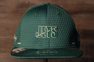 Jets 2020 Training Camp Snapback Hat | New York Jets 2020 On-Field Green Training Camp Snap Cap the front of this jets training cap has the jets name and a flatbrim