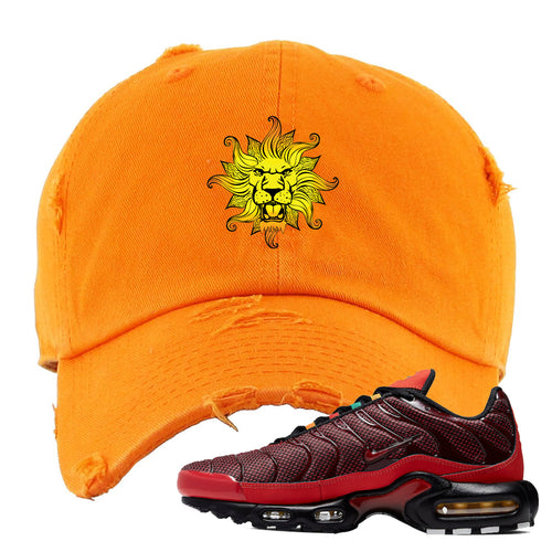 embroidered on the front of the air max plus sunburst sneaker matching orange distressed dad hat is the vintage lion head logo
