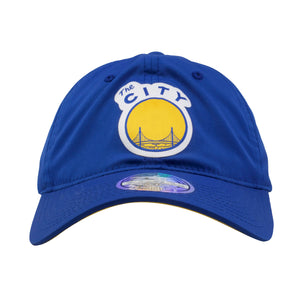 on the front of the golden state warriors blue poly dad hat is the Warriors vintage The City logo in yellow, white, and blue