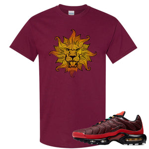 printed on the front of the air max plus sunburst sneaker matching maroon tee shirt is the vintage lion head logo