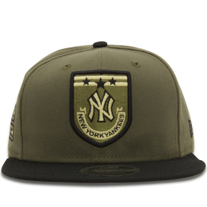 Embroidered on the front of the New York Yankees Military Style Snapback Hat is a patch featuring the New York Yankees, three stars, and the lettering saying New York Yankees