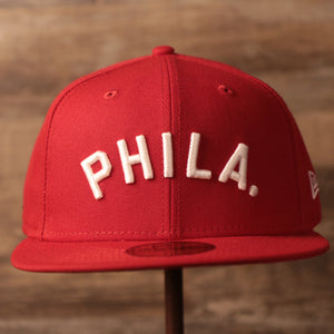 The Phils red New Era fitted cap with red underbrim.