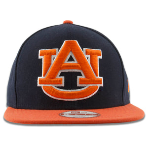 Embroidered on the front of the Auburn University XL logo snapback hat is the AU logo in orange with a white trim
