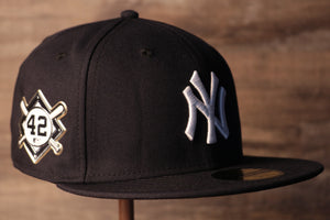 This is a perfect hat to remember jackie robinson with Yankees Jackie Robinson Fitted Cap | New York Yankees On-Field Jackie Robinson Side Patch Navy Fitted Hat