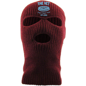 Embroidered on the front of the veterans stadium maroon 3 hole ski mask is the vet logo