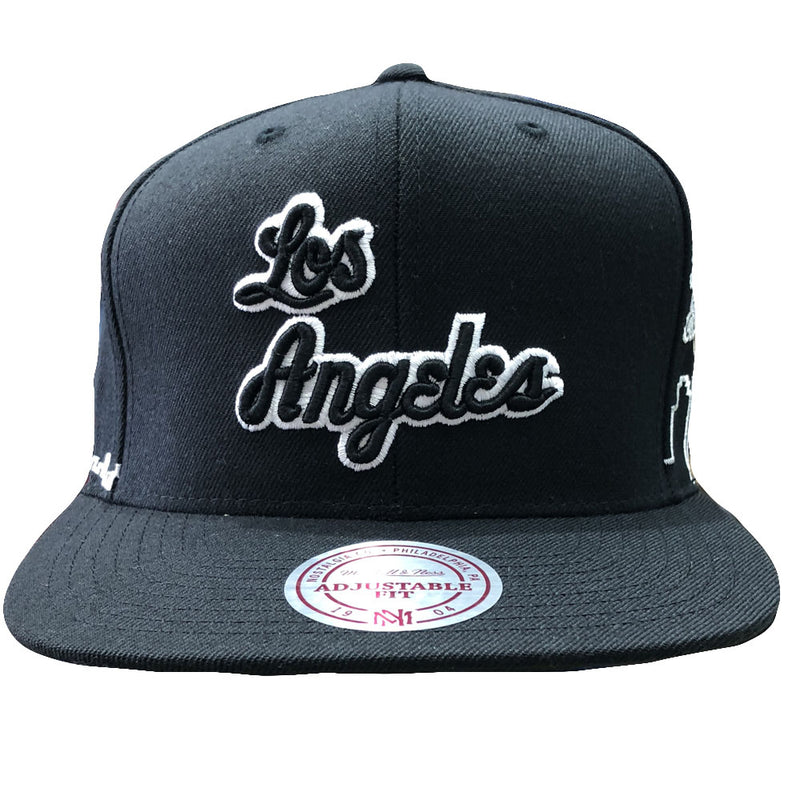 Embroidered on the front of the Los Angeles Lakers city skyline snapback hat is the Los Angeles script logo in black and white