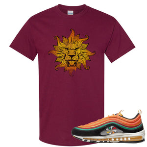 Printed on the front of the Air Max 97 Sunburst maroon sneaker matching tee shirt is the Vintage Lion Head logo