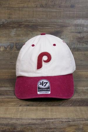 on the front of the Philadelphia Phillies Dad Hat | Cooperstown Collection Vintage Fuzzy Logo Bone and Red Baseball Cap is the 1970s Phillies P logo