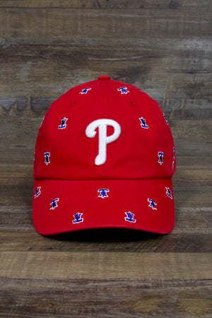on the front of the Philadelphia Phillies Womens Dad Hat | Confetti Bell Print Red Strapback Baseball Cap is the current white Phillies logo