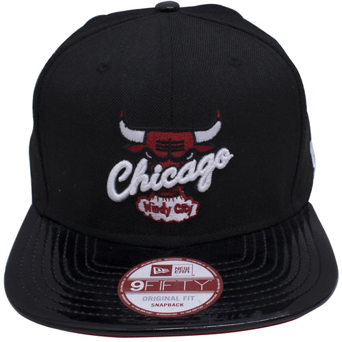 "Black structured hat with the Chicago Bulls logo on front in White and Red. Cursive font of the ""Chicago"" is laid across in front of the Bulls in a slight diagonal. The classic windy city logo is on the bottom of the main logo and in white and red. The bill is made with black patent leather made to match the Air Jordan 11s Low Bred."