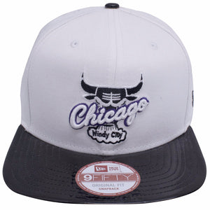 on the front of the Chicago Bulls Air Jordan Retro 11 Concord sneaker matching snapback hat has a white crown and black patent leather brim with a vintage Chicago Bulls windy city logo embroidered on the front in white, black, and purple
