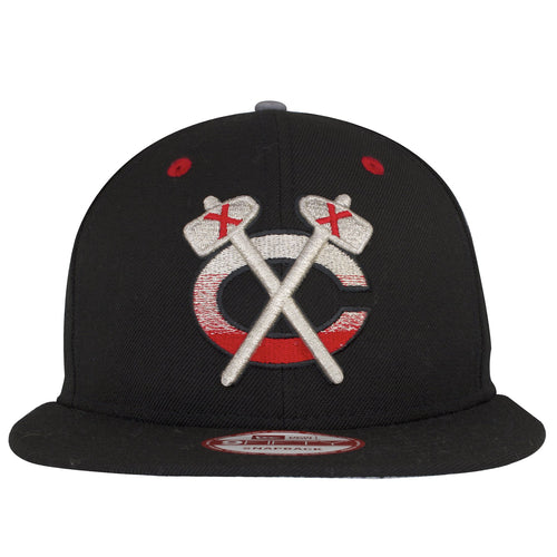 on the front of the black chicago blackhawks snapback hat is a chicago black hawks logo embroidered in silver and red