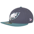 on the left side of the philadelphia eagles made in usa low crown fitted cap, the new era logo is embroidered in white, red, and blue