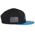 Sideways American flag in light gray and black is embroidered on the right side of this Carolina Panthers Sideline Snapback.