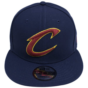 on the front of the new era classic Cleveland Cavaliers Navy Blue snapback hat is the Cleveland Cavaliers logo embroidered in maroon and gold