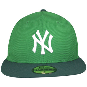 on the front of the new york yankees irish green st patrick's day fitted cap is the new york yankees logo embroidered in solid white