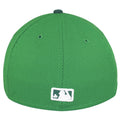 on the back of the new york yankees st patricks day fitted cap is the mlb logo embroidered in white and green