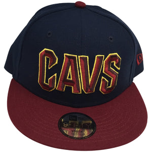 on the front of the cleveland cavaliers kids sized snapback hat is the cavs lettering embroidered in maroon and gold