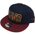the cleveland cavaliers youth snapback hat has a navy blue crown and a maroon brim