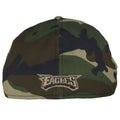 on the back of the philadelphia eagles woodland camouflage stretch fit can is the eagles wordmark embroidered in brown and black