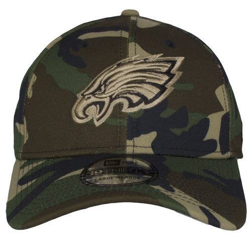 on the front of the tonal philadelphia eagles woodland camouflage stretch fit cap is a tonal eagles logo embroidered in brown and black
