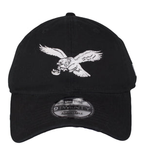 on the front of the philadelphia eagles vintage dad hat is the throwback eagles logo emboridered in white black