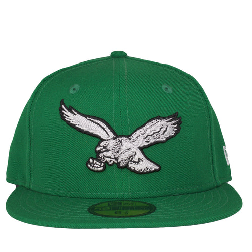 on the front of the kelly green vintage Philadelphia Eagles fitted cap is the retro Eagles logo embroidered in white and black