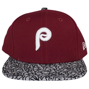 The logo on the front of this Vintage Cooperstown Philadelphia Phillies Snapback hat is heavily embroidered with white threading. The flat bill of this Throwback Phillies Vintage Hat is design based on the Jordan sneaker designs with the same material.