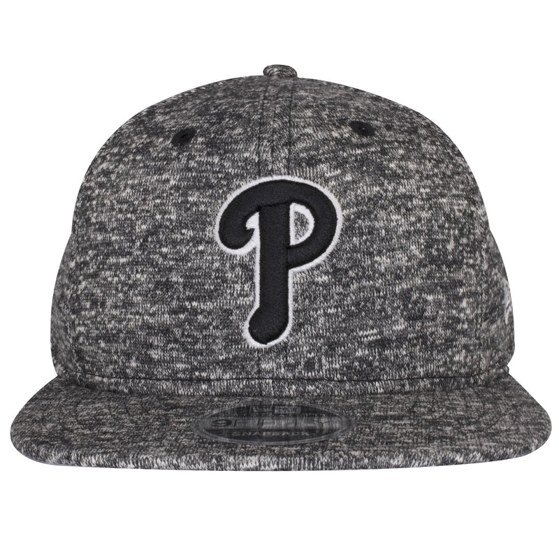 The front of this New Era Phillies Hat shows the Philadelphia Phillies logo heavily embroidered with black threading.
