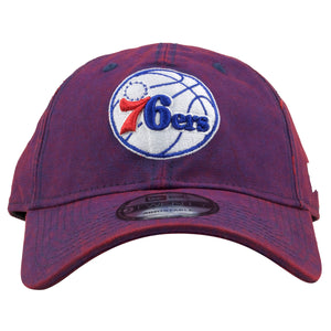 the front of the Philadelphia 76ers purple hue dad hat is the Philadelphia 76ers logo embroidered in white, red, and blue